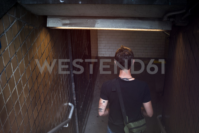USA, New York City, Man walking down steps of Metro station - ONF000882