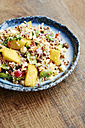 Quinoa salad with mango, carrots, fava beans, red bell pepper, red onion, corn, coconut and raisins - HAWF000847