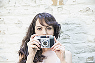 Woman taking pictures with camera - FMKYF000617