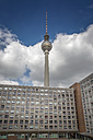 Germany, Berlin, view to television tower with concrete tower block in the foreground - NKF000376