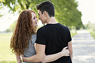 Teenage couple in love arm in arm - GDF000851