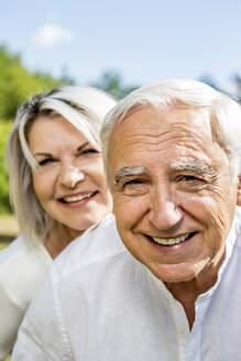 Portrait of happy elderly couple outdoors - RKNF000346
