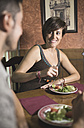 Couple eating a salad in restaurant - JAS000026