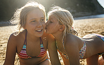 Two sisters having fun together on the beach - MGOF000605