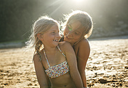 Two sisters having fun together on the beach - MGOF000607