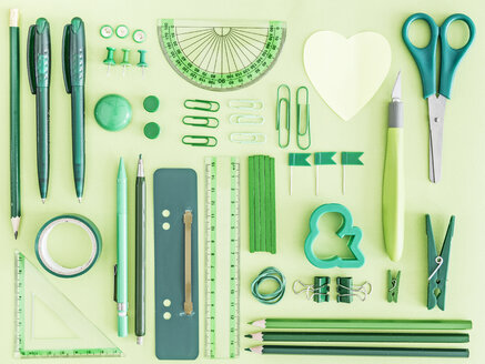Green office supplies on green background - MELF000070