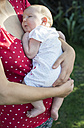 Baby girl in the arms of her mother - DEGF000514