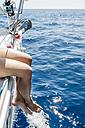 Spain, Mallorca, Woman sitting on sailing boat - JRFF000035