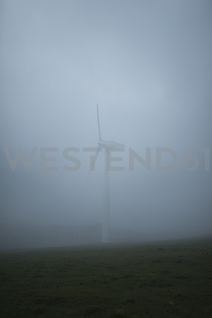 Spain, Ortigueira, wind turbine at heavy fog - RAEF000438