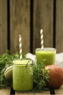 Carrot apple smoothie, preserving jar with drinking straw - ODF001246