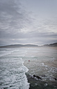 Spain, Galicia, Ferrol, bodyboarder alone at the sea - RAEF000451