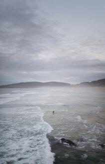 Spain, Galicia, Ferrol, bodyboarder alone at the sea - RAEF000451