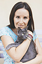Woman holding Russian Blue - GEMF000341