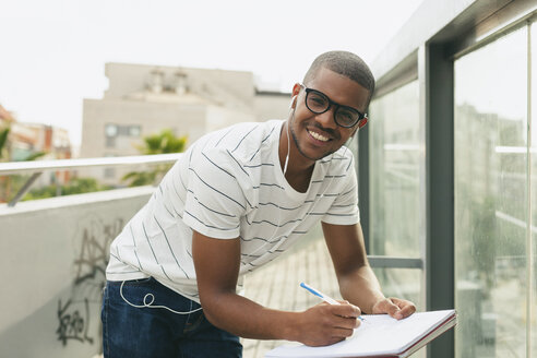 Young Afro-american man studying language - EBSF000863