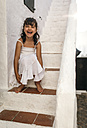 Spain, Balearic Islands, Menorca, Binibeca, portrait of laughing little girl sitting on a step - MGOF000649