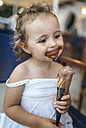 Portrait of smiling little girl with chocolate icecream around her mouth - MGOF000657