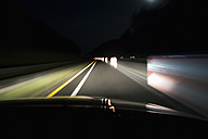 Driving on empty street at night - NDF000541