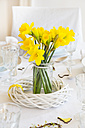 Laid table with daffodils at springtime - LVF003765