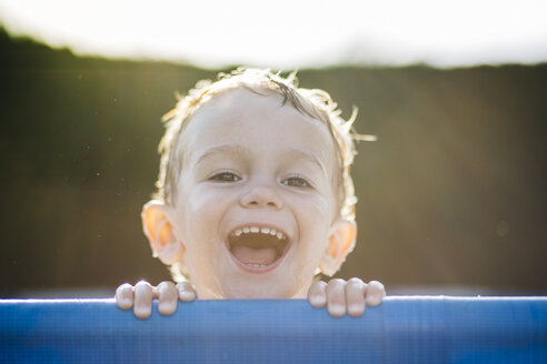 Portrait of laughing little boy at backlight - JRFF000043