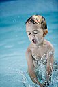 Little boy splashing in a paddling pool - JRFF000049