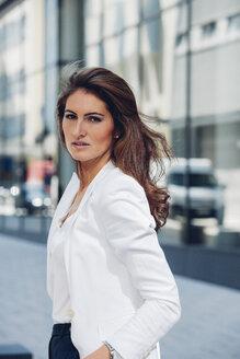 Portrait of confident businesswoman outdoors - CHAF001420