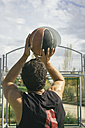 Man aiming at basketball hoop - ABZF000110