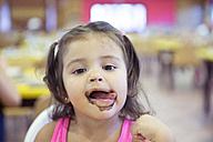 Portrait of little girl covered with ice cream - ERLF000020