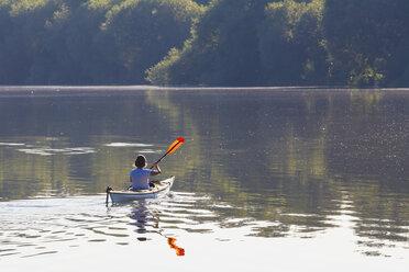 Germany, Stuttgart, woman kayaking on Max-Eyth-See - WDF003245