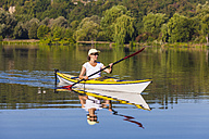 Germany, Stuttgart, woman kayaking on Max-Eyth-See - WDF003247