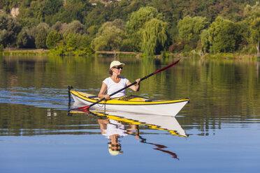Germany, Stuttgart, woman kayaking on Max-Eyth-See - WDF003247