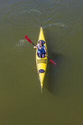 Germany, woman kayaking - WDF003252