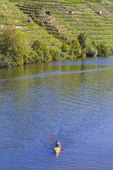 Germany, woman kayaking on Neckar - WDF003257