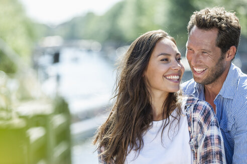 Netherlands, Amsterdam, happy couple outdoors - FMKF002133