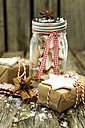 Preserving jar of home-baked cinnamon stars and Christmas presents - ODF001284