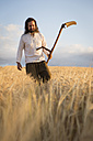 Organic farmer with scythe in barley field - MIDF000603