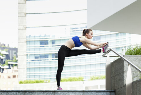 Young woman doing workout in the city - PASF000016