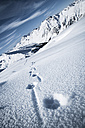 Austria, Tyrol, Ischgl, winter landscape in the mountains with tracks in snow - ABF000660