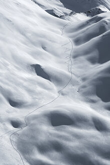 Austria, Tyrol, Ischgl, ski tracks in powder snow - ABF000665