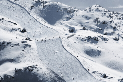 Austria, Tyrol, Ischgl, skiers on slope in winter landscape - ABF000649