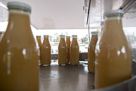 Apple juice is being bottled in a bottling plant - TKF000416