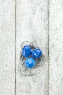 Blue Easter eggs on wood - ASF005690
