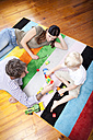Parents playing with their little son on the carpet of children's room - MFRF000411