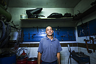 Portrait of mechanic in his workshop - JASF000100