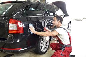 Car cleaning, man polishing car - LYF000492