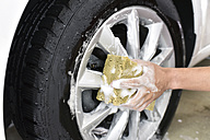 Car cleaning, man cleaning car, washing the alloy wheel - LYF000485