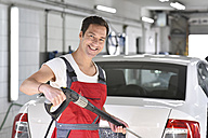 Car cleaning, man cleaning car with high-pressure cleaner - LYF000487
