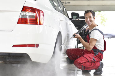 Car cleaning, man cleaning car with high-pressure cleaner - LYF000490