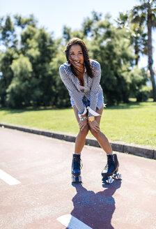 Spain, Gijon, happy teenage girl on roller skates - MGOF000984