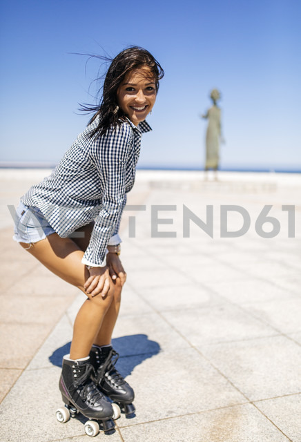 Spain, Gijon, smiling teenage girl on roller skates - MGOF000998 - Marco Govel/Westend61