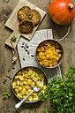 Veggie burgers, bowl of prepared pumpkin, gnocchi and Hokkaido pumpkin - ODF001305